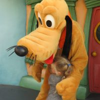 Getting a cuddle from Pluto in Toon Town