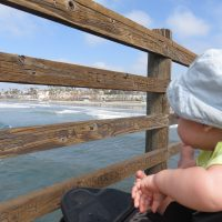 Baby Bum watching the surfers in action - Oceanside, California